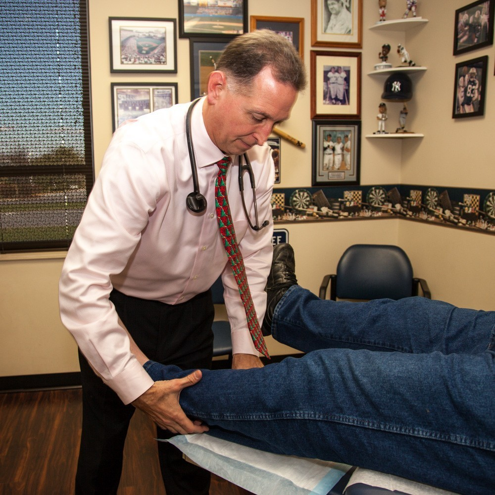 Dr. Seretis examining a patients leg