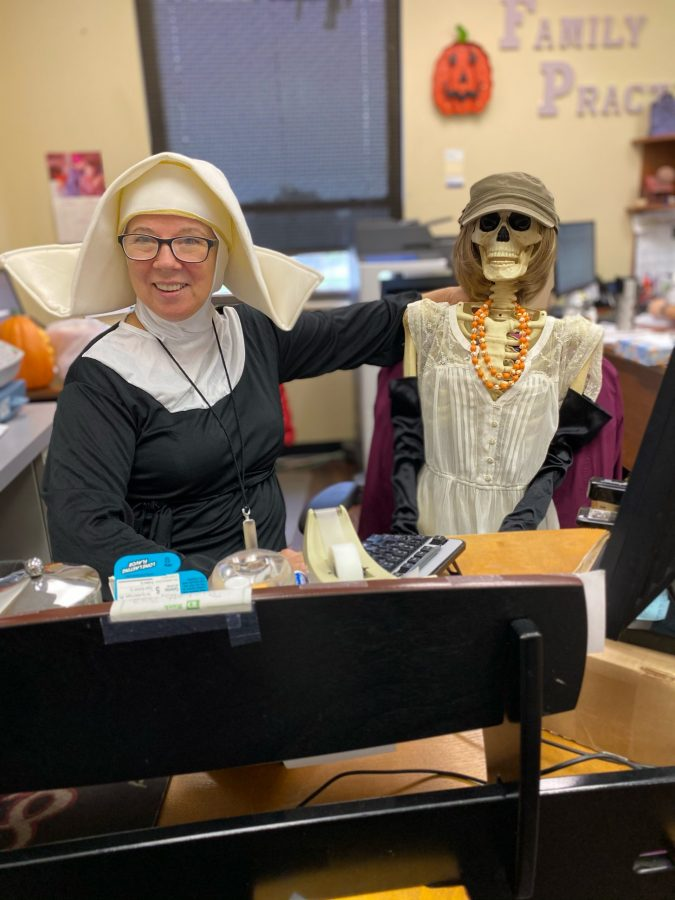Wanda dressed as a nun for halloween with a skeleton sitting next to her
