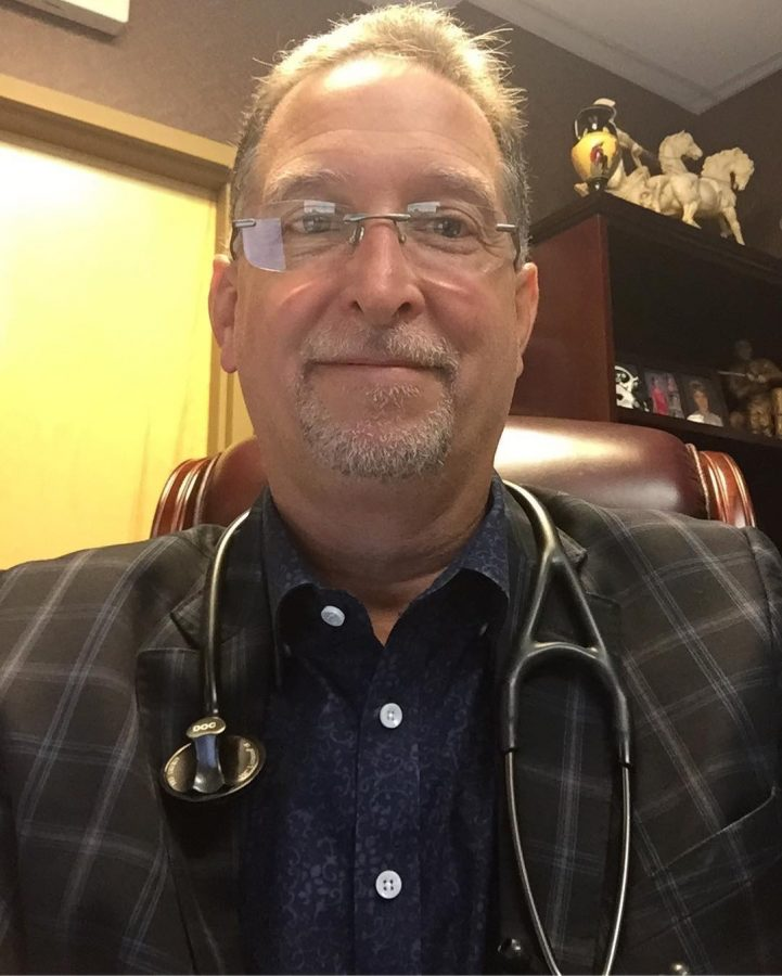 Dr. Seretis with stethoscope around his neck