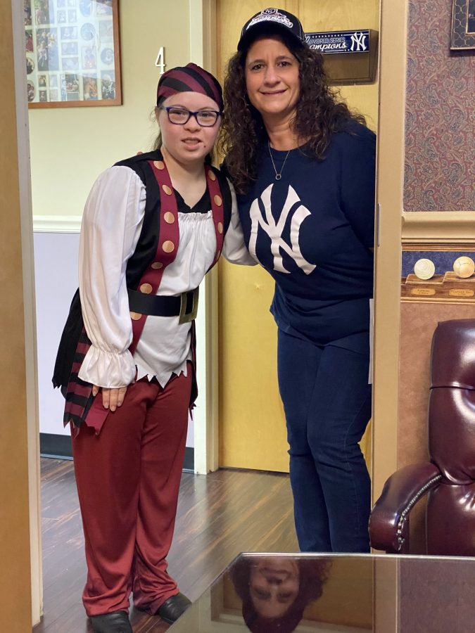 Gina Oteri posing with young patient who is dressed in a pirate costume