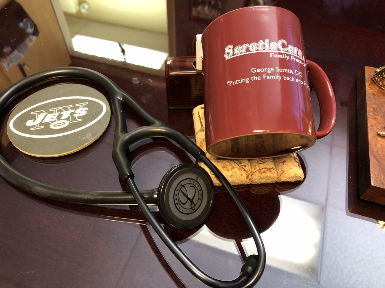 Seretiscare mug and stethoscope on desktop